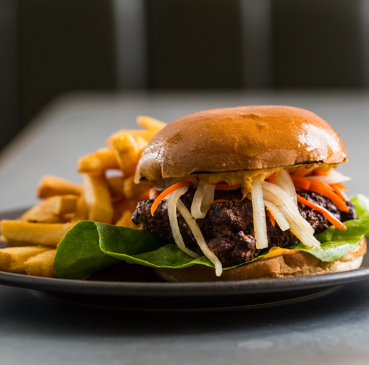Chicken Burger | marinated deep-fried chicken thigh, chilli mayo, butter lettuce, pickled carrot & daikon | 22
