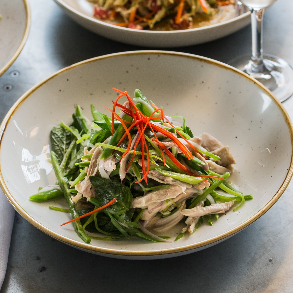Poached Chicken | snow peas, green beans, bean sprouts, eschallots, Asian herbs, chilli & coconut-lime dressing | 22
