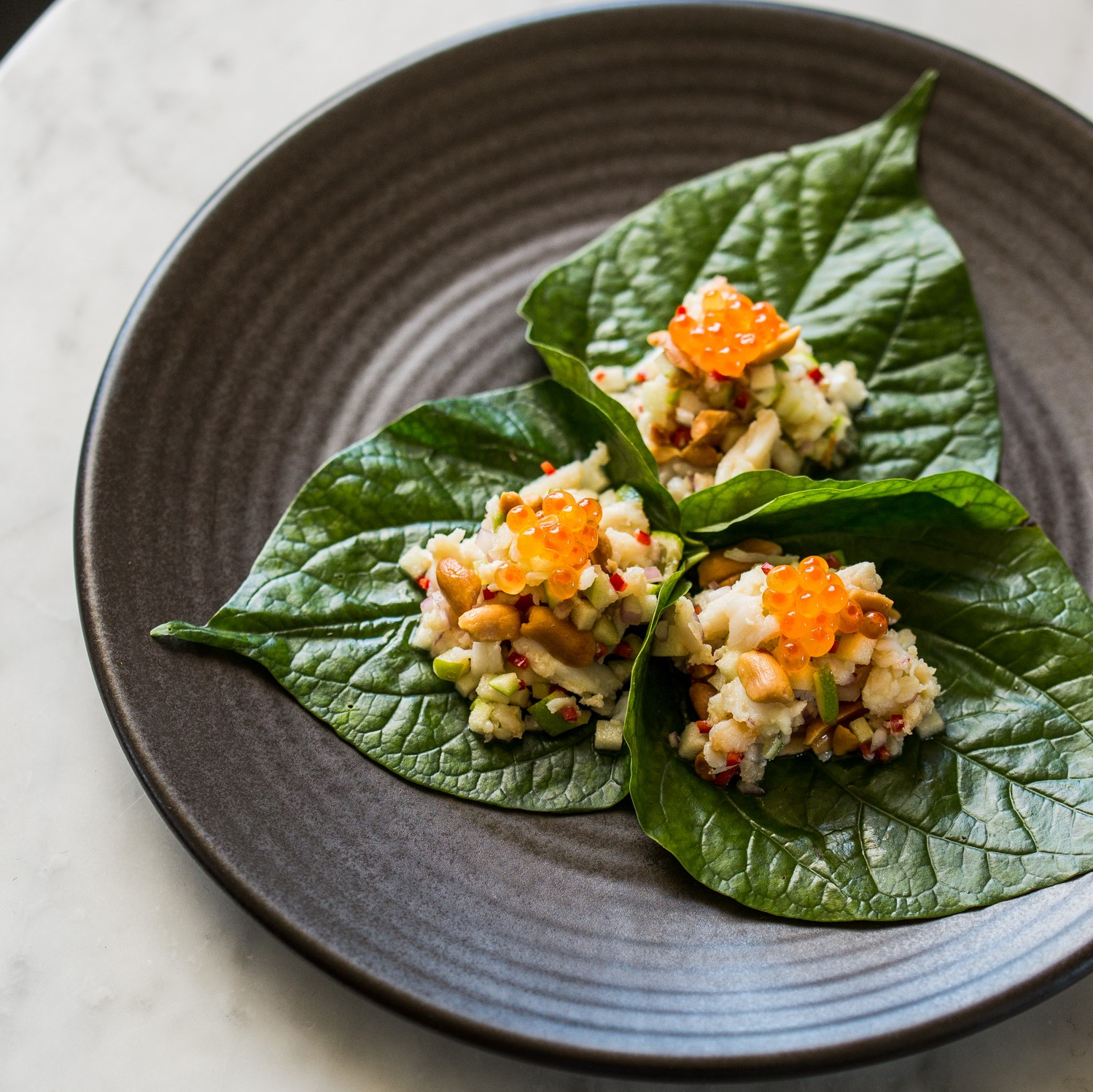 Betel Leaf | spanner crab, chilli, peanuts, granny smith apple, salmon roe (GF) | 18